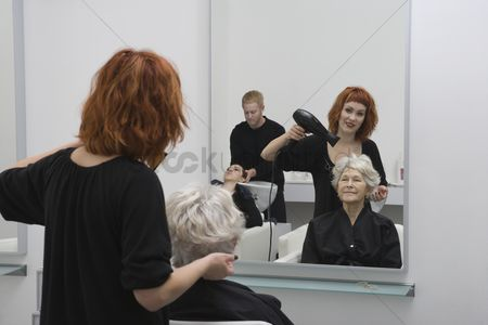 Client : Stylist blow-drys elderly woman s hair