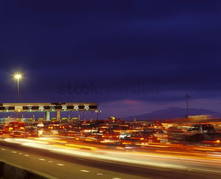 Transportation : Tail backs of traffic at toll gate in california