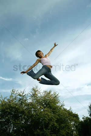 Celebrating : Teenage girl jumping with joy