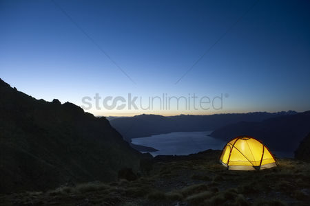 Remote : Tent by lakeshore at dusk