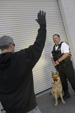 Thief : Thief with raised arms and security guard with dog