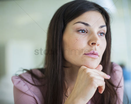 Czech republic : Thoughtful young businesswoman looking away in office