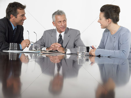 Business suit : Three business colleagues in conference meeting