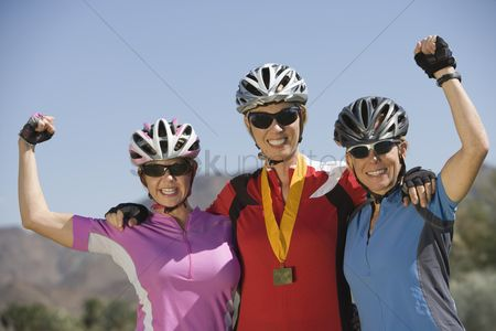 Arm raised : Three female cyclists win cycling contest
