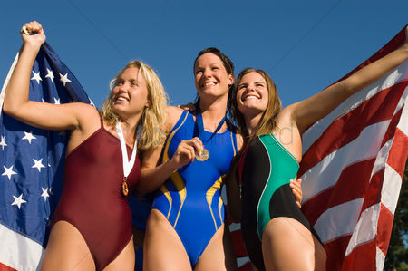 Swimmer : Three female swimmers celebrating victory  low angle view