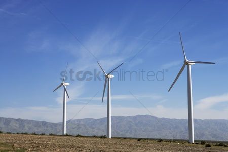 Land : Three wind turbines in desert