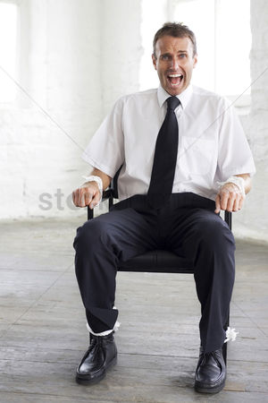 Forbidden : Tied up businessman screaming for help