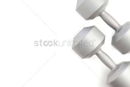 Strong : Top view of dumbbells on white background with copy space