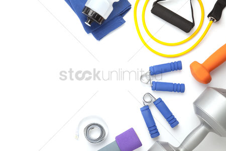 Fitness : Top view of fitness equipment on white background with copy space