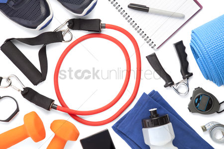 Strong : Top view of fitness equipment on white background with copy space