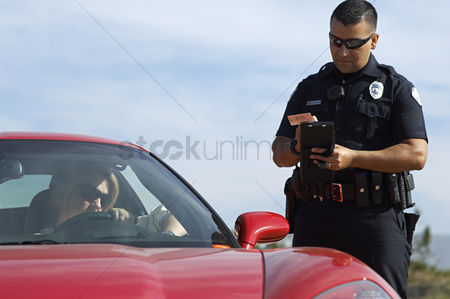 Transportation : Traffic cop standing by sports car