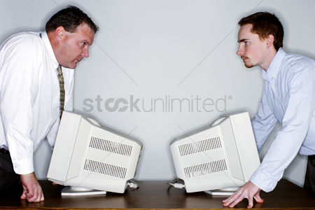 Fury : Two businessmen looking at each other angrily