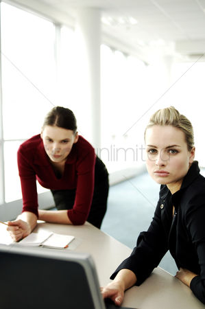 Composed : Two businesswomen having discussion