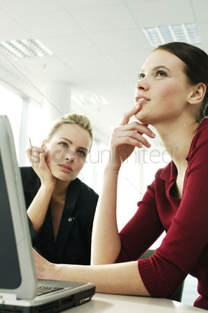 Two people : Two businesswomen thinking
