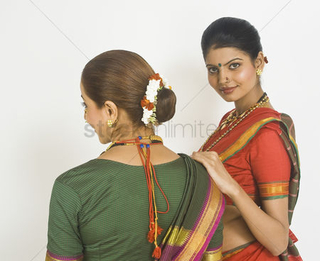 Dance : Two female folk dancers standing together in traditional maharashtrian dress