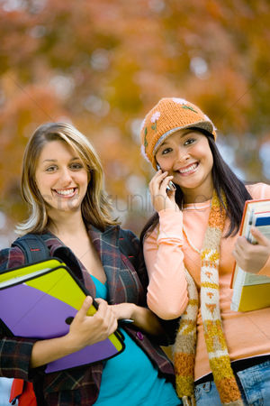 University : Two female students outdoors  portrait