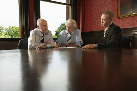 Leadership : Two older men and one younger man in meeting