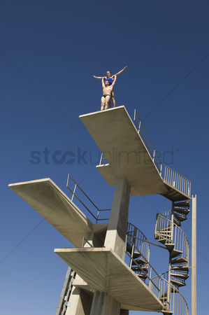 Diving : Two swimmers standing on diving board