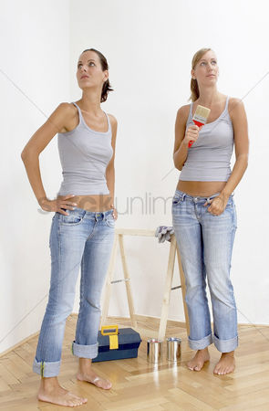 Paint brush : Two women getting ready to paint their house