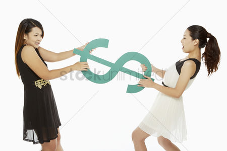 Fight : Two women pulling a dollar sign