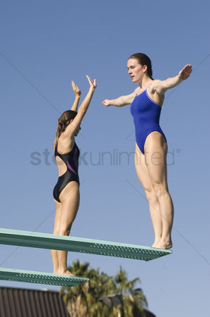 Diving : Two women standing on diving boards