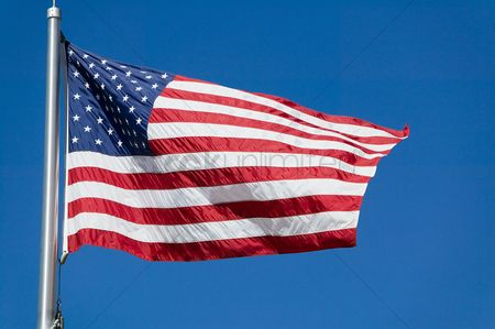 Us : United states flag flapping against clear sky  low angle view