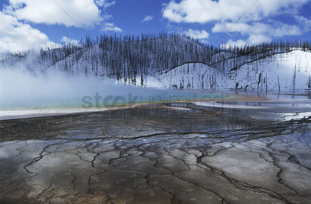 Spring : Usa wyoming yellowstone national park grand prismatic spring mist over hot spring in winter landscape