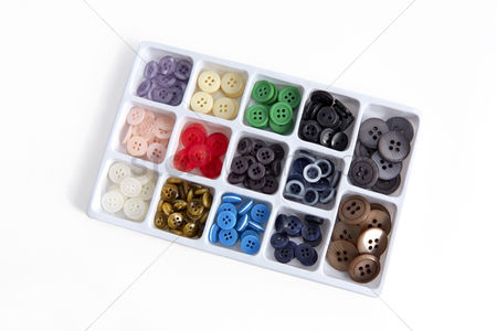 Selection : Variety of sewing buttons in a storage box