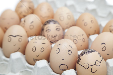 Egg tray : Various facial expressions painted on brown eggs in egg carton