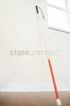 Tidy : Walking stick against a wall