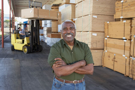 Forklift : Warehouse worker in front of man working with forklift