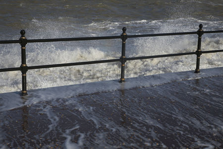 England : Water crashing over rail