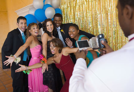 Dance : Well-dressed teenagers posing for video camera at school dance