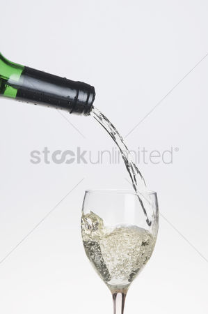 Wine bottle : Wine pouring from a bottle into a glass