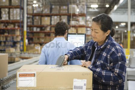 Interior background : Woman and man working in distribution warehouse