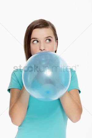 Blowing : Woman blowing balloon