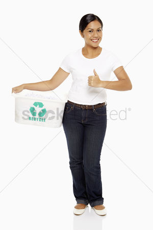 Bidayuh ethnicity : Woman carrying a plastic box with a recycle logo on it  showing hand gesture