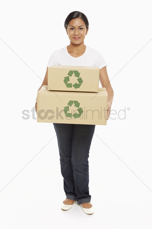 Bidayuh ethnicity : Woman carrying a stack of cardboard boxes