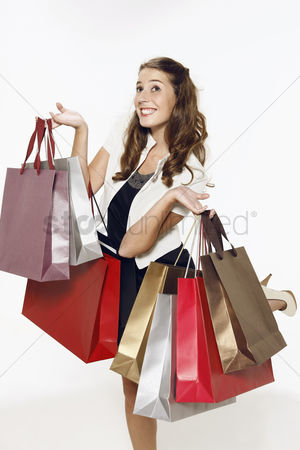 Shopping background : Woman carrying shopping bags