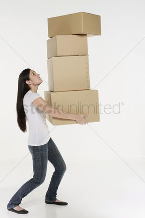 Interior background : Woman carrying stack of boxes
