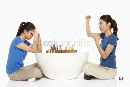 Malaysian chinese : Woman cheering after winning a game of chess