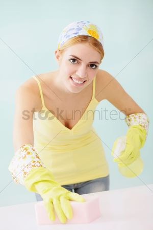 Housewife : Woman cleaning table