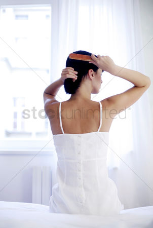 Fashion : Woman combing her hair