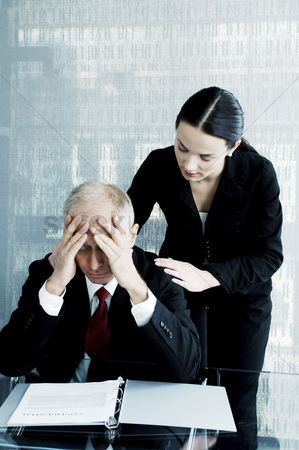 Loss : Woman comforting a stressed out businessman