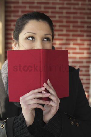 Cold temperature : Woman daydreaming while holding book