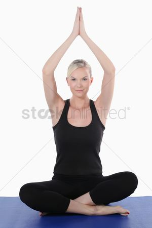 Practising yoga : Woman doing a yoga pose