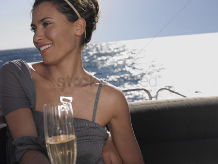Women group outside : Woman drinking champagne on boat