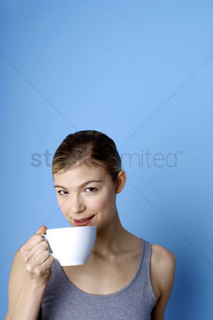 Refreshment : Woman drinking coffee