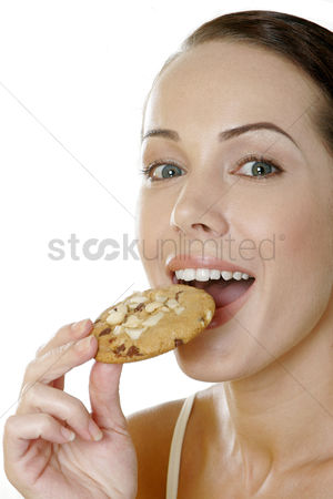 Satisfying : Woman eating cookies