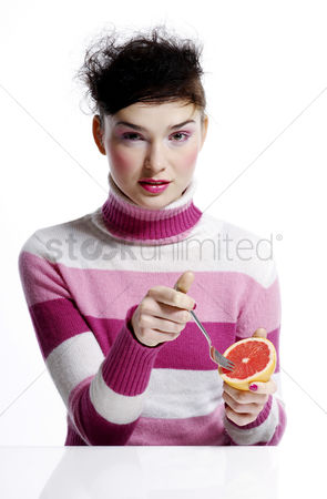 Composed : Woman eating orange